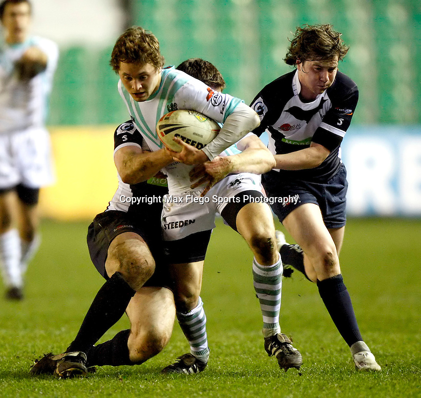 George Sykes powers forward for Cambridge during the 29th Pcubed Rugby League Varsity game between Oxford and Cambridge at the Twickenham Stoop on Thursday March 5, 2009