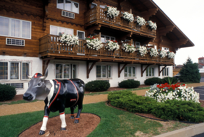 "New Glarus, WI, Wisconsin, ""Little Switzerland"", Painted swiss cow outside The Chalet Landhaus Inn in the town of New Glarus."