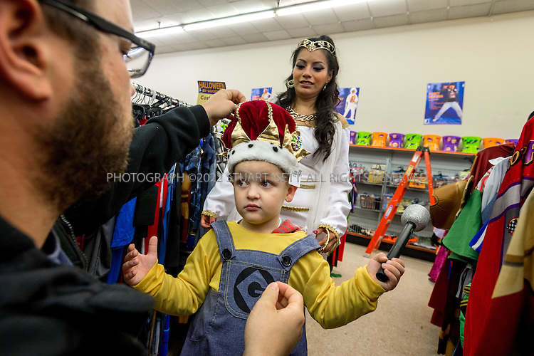 10/28/2015 &mdash; Tacoma, Washington, USA<br /> <br /> Morena Ledesma, 29, an employee at Goodwill Halloween store in Tacoma, WASH., helps people put together costumes. Here she helps 4 year old Myles Madden and his father, Justin Madden, 28, find the young boy a costume a few days before Halloween.<br /> <br /> <br /> CREDIT: Stuart Isett for The Wall Street Journal<br /> Slug: GOODWILL
