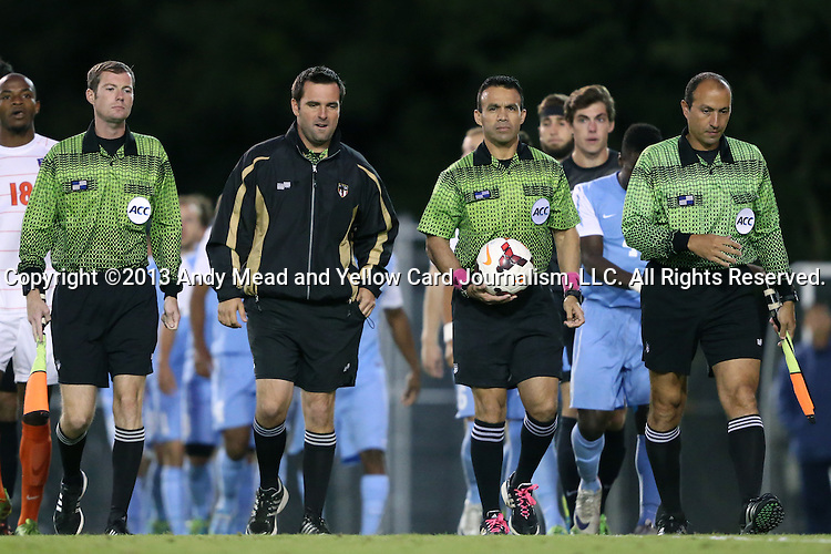 08 October 2013: Match officials. From left: Assistant Referee Cory Richardson, Fourth Official Bradley Shrader, Referee Hilario Grajeda, Assistant Referee Saeed Mohamed. The University of North Carolina Tar Heels hosted the Clemson University Tigers at Fetzer Field in Chapel Hill, NC in a 2013 NCAA Division I Men's Soccer match. Clemson won the game 2-1 in overtime.