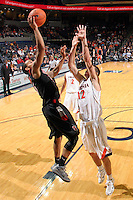 Dec. 22, 2010; Charlottesville, VA, USA; Seattle Redhawks guard Cervante Burrell (5) shoots in front of Virginia Cavaliers guard Joe Harris (12) during the game at the John Paul Jones Arena. Seattle Redhawks won 59-53. Mandatory Credit: Andrew Shurtleff
