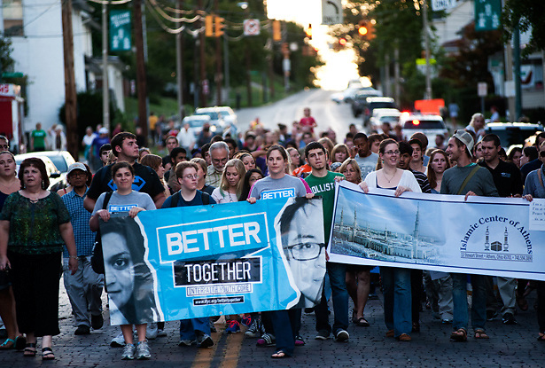 Ohio University students and Athens residents march down west state street during the Interfaith Walk. Photo by: Ross Brinkerhoff.