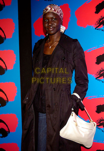 ALEK WEK.Fourth Day of the Milan Fashion Week (Milano Moda Donna) Tod's Party Woman's Collection autumn/winter 2006/07, Milan, Italy..February 21st, 2006.Ref: Garofalo/Omega/Capital Pictures.Ref: G/OME.4th half length black coat white purse bag headscarf.www.capitalpictures.com.sales@capitalpictures.com.© Capital Pictures.