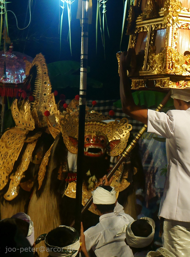 Barong spirit (positive, protective power) meets divine witch Rangda, enclosed in golden box, night ceremonies in village Taro, Bali, archipelago Indonesia. Later, the mask of divine witch Rangda will be taken out of the golden box, a villager will put on the mask and incarnate the goddess in half-trance. Rangda is also connected to Hindu godess Kali. Ceremonies for Rangda in Taro lasted all night, aprox. from 11pm to 5am. Spiritual cosmos of Balinese Hinduism,  rooted in local acient animism, consists of dual power, positive (Barong) and negative (witch Rangda), good and evil as a nescessary balance. Both opposite powers are worshipped and respected.