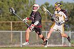 Palos Verdes, CA 03/30/10 - Wesley Hebert (Palos Verdes #32) and Clay Benjamin (Peninsula #3) in action during the Palos Verdes-Peninsula JV Boys Lacrosse game.