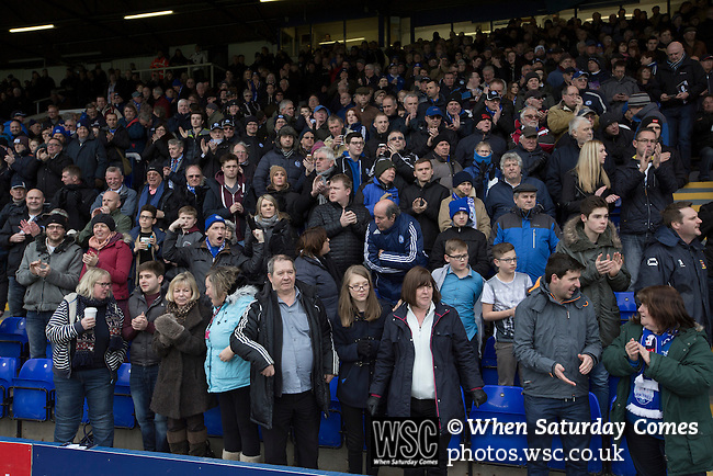 Peterborough United 1 Chesterfield 0, 21/03/2015. Abax Stadium, League One. Home club supporters watching the teams walking onto the pitch at the Abax Stadium, before Peterborough United play Chesterfield in a SkyBet League One fixture. The home team won the match by one goal to nil, watched by a crowd of 6,612. The result allowed Peterborough to leapfrog their opponents into the League One play-off positions with eight games remaining of the season. Photo by Colin McPherson.