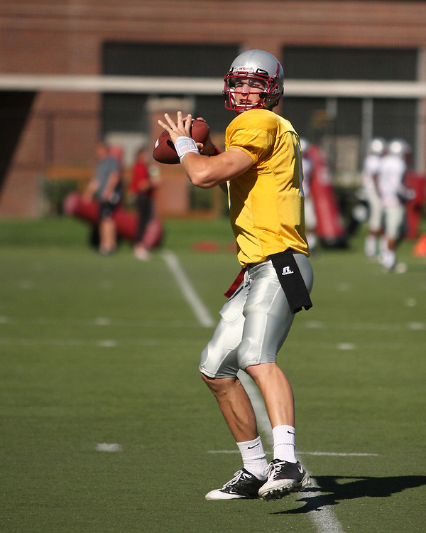 Gary Rogers, senior quarterback of the Washington State Cougars, throws a pass during a passing drills portion of fall practice on August 11, 2008, at the WSU practice field in Pullman, Washington.  He came out of fall practice as the starting quarterback, but suffered a season-ending injury in the Portland State game early in the season.
