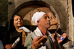 Israel, Jerusalem Old City, Egyptian pilgrim at the Church of the Holy Sepulchre on Holy Saturday. Easter 2005<br />