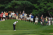 Bethesda, MD - July 4, 2007 -- Tiger Woods putts on the green during the inaugural Earl Woods Memorial Pro-Am.  Woods teed off in the early morning with AT&T Chairman Randall Stephenson, Army Sergeant Major Mia Kelly and Air Force Sergeant Andrew Amor for a round of 18 holes at Congressional Country Club in Bethesda, Maryland on Wednesday, July 4, 2007.   Woods and company was later joined near the 16th hole by former United States President George H.W. Bush and his wife Barbara.  The commemorative occasion pays tribute to the many courageous men and women serving in our armed forces during the week of our nation's independence celebration. .Credit:  Johnny Bivera - DoD via CNP.