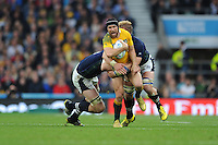 Matt Giteau of Australia is stopped in his tracks by Richie Gray and Dave Denton of Scotland during the Quarter Final of the Rugby World Cup 2015 between Australia and Scotland - 18/10/2015 - Twickenham Stadium, London<br /> Mandatory Credit: Rob Munro/Stewart Communications