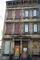 Dilapidated brownstones seen in Harlem in New York on Sunday, June 23, 2013. (© Frances M. Roberts)