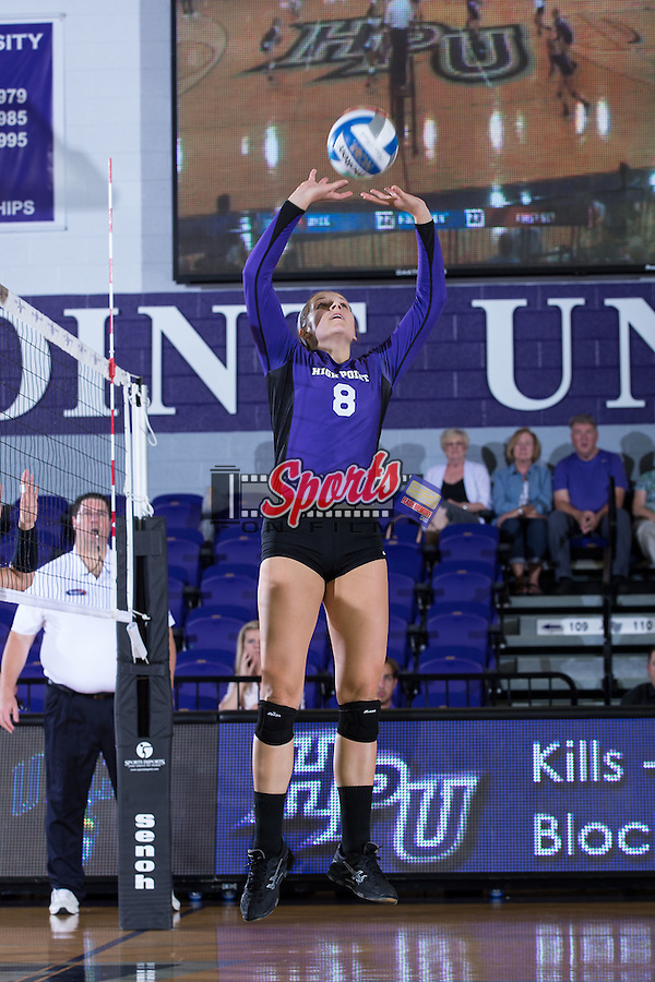 Gabi Mirand (8) of the High Point Panthers sets the ball during the match against the UNC Greensboro Spartans at Millis Athletic Center on September 16, 2014 in High Point, North Carolina.  The Panthers defeated the Spartans 3-0.   (Brian Westerholt/Sports On Film)