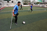 Disabled Palestinians who were lost their limbs participate in football training, in Gaza City on May 10, 2018. Photo by Mahmoud Ajour