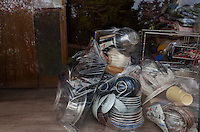 Personal belongings packed in polythene and abandoned in a house in the town of Tomioka, Futaba District of Fukushima, Japan. Monday April 29th 2013. The town was evacuated on March 12th after the March 11th 2011 earthquake and tsunami cause meltdowns at the nearby Fukushima Daichi nuclear power station. It lies well within the 20 kms exclusion zone though parts of the town have recently been opened again to allow locals to visit their property during daylight hours.