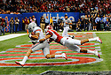 Ohio State University wide receiver DeVier Posey scores during the second quarter of the Allstate Sugar Bowl in New Orleans, Louisiana January, 4, 201. The Ohio State Buckeyes defeated the Arkansas Razorbacks, 31- 26.<br /> <br /> <br /> <br /> (Cheryl Gerber/AP Images for Allstate)