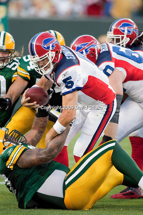 Green Bay Packers defensive lineman Johnny Jolly (97) sacks Buffalo Bills quarterback Trent Edwards (5) during an NFL preseason game on August 22, 2009, in Green Bay, Wisconsin. (AP Photo/David Stluka)