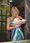 .AbilityFilms@yahoo.com 805-427-3519.www.AbilityFilms.com.5-3-08 Paris HIlton shopping at Yellow dog pet shop in los angeles. Paris bought some toys and a huge sleeping pad.