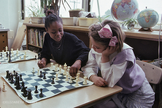Berkeley CA Girls playing chess together in 3rd grade class
