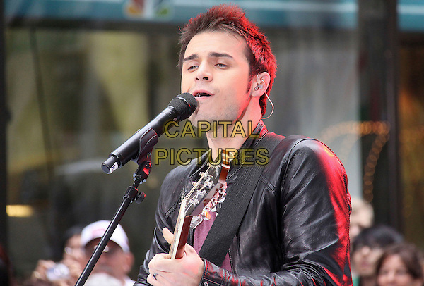 """KRIS ALLEN .American Idol winner Kris Allen performs live on NBC's """"Today Show"""", New York, NY, USA, 28th May 2009..half length black leather jacket guitar playing microphone performing singing on stage playing live .CAP/ADM/PZ.©Paul Zimmerman/Admedia/Capital Pictures"""
