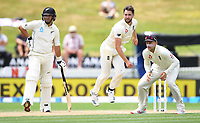 3rd December, Hamilton, New Zealand;  England's Chris Woakes bowling as Ross Taylor and Joe Root look on during play day 5 of the 2nd test cricket match between New Zealand and England at Seddon Park, Hamilton, New Zealand.