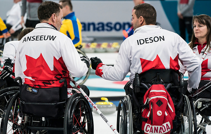 PyeongChang 14/3/2018 - Alternate Jamie Anseeuw and skip Mark Ideson as Canada takes on Slovakia in wheelchair curling at the Gangneung Curling Centre during the 2018 Winter Paralympic Games in Pyeongchang, Korea. Photo: Dave Holland/Canadian Paralympic Committee