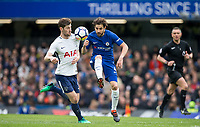 Cesc Fabregas of Chelsea & Ben Davies of Spurs during the Premier League match between Chelsea and Tottenham Hotspur at Stamford Bridge, London, England on 1 April 2018. Photo by Andy Rowland.