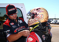 Sept. 22, 2013; Ennis, TX, USA: Crew member helps NHRA top fuel dragster driver Billy Torrence during the Fall Nationals at the Texas Motorplex. Mandatory Credit: Mark J. Rebilas-