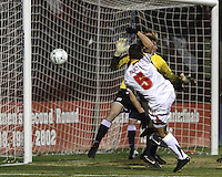 Doug Rodkey #5 of the University of Maryland blasts a shot past Andres Casais #6 and Brendan Birmingham #28 of Penn State during an NCAA 3rd. round match at Ludwig Field, University of Maryland, College Park, Maryland on November 28 2010.Maryland won 1-0.
