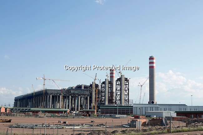 The newly constructed Medupi power station stands outside the northern South African town of Lephalale. The plant, operated by the state company Eskom will be the fourth largest in the world and is expected to produce electricity in early 2015. Medupi is touted as Africa's first 'supercritical' coal plant, using higher temperatures that produce more energy from less coal, while emitting less ash and carbon dioxide. South Africa, like China and India, has large domestic coal supplies that provide a cheap source of energy to meet an ever-growing demand.