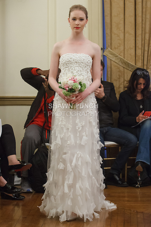 Model walks runway in a Ginger bridal gown from the Peter Langner Bridal collection 2017, at the 3 West Club on April 16, 2016 during New York Bridal Fashion Week Spring Summer 2017.