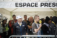 FDJ team boss Marc Madiot taking shelter in the press tent at the finish as rain & hail hit the finish zone<br /> <br /> finish of stage 9 in Andorra Arcalis (coming from Velha Val d'Aran/ESP, 184km)<br /> 103rd Tour de France 2016