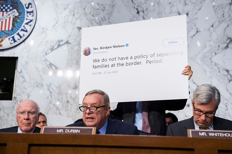 """UNITED STATES - JULY 31: Sen. Richard Durbin, D-Ill., cites a tweet by Department of Homeland Security Secretary Kirstjen Nielsen, during a Senate Judiciary Committee hearing in Hart Building titled """"Oversight of Immigration Enforcement and Family Reunification Efforts,"""" on July 31, 2018. (Photo By Tom Williams/CQ Roll Call)"""