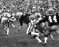 Oakland Raider punter Ray Guy takes off running on a fake punt against the Pittsburg Steelers. (1973 photo by Ron Riesterer)