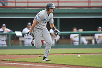 West Michigan Whitecaps shortstop Daniel Pinero (21) runs out a bunt attempt during a game against the Burlington Bees at Community Field on May 11, 2017 in Burlington, Iowa.  The Whitecaps won 10-3.  (Dennis Hubbard/Four Seam Images)