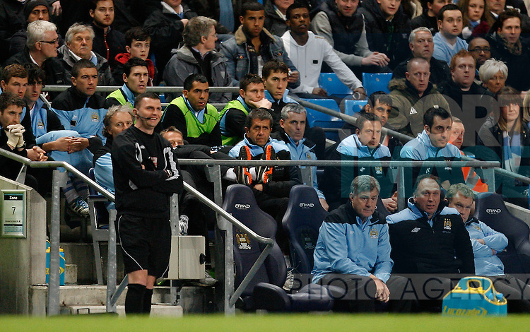 Manchester City's Carlos Tevez (C) and the bench during the match..Barclays Premier League match between Manchester City v Chelsea at the Etihad Stadium, Manchester on the 21st March 2012..Sportimage +44 7980659747.picturedesk@sportimage.co.uk.http://www.sportimage.co.uk/.