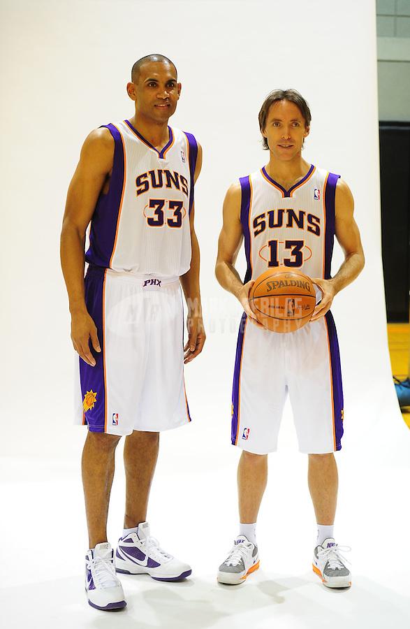 Dec. 16, 2011; Phoenix, AZ, USA; Phoenix Suns forward Grant Hill (left) and guard Steve Nash pose for a portrait during media day at the US Airways Center. Mandatory Credit: Mark J. Rebilas-