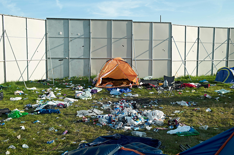 170828 - &copy; John Angerson<br /> The aftermath of Reading Festival start the huge clean-up operation begins.Thousands of revellers decided to ditch their tents in the fields following the bank holiday weekend rock festival. Over half a dozen fields where festival-goers camped are now littered with rubbish and abandoned tents.