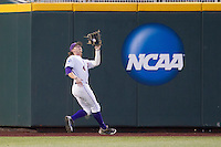 LSU Tiger outfielder Raph Rhymes (4) makes a running catch on the warning track during Game 4 of the 2013 Men's College World Series against the UCLA Bruins on June 16, 2013 at TD Ameritrade Park in Omaha, Nebraska. UCLA defeated LSU 2-1. (Andrew Woolley/Four Seam Images)
