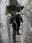 Climbing down the ladder with the rebreather at Hodge Close