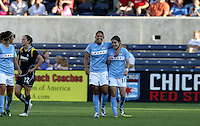 Chicago Red Stars forwards Cristiane (11) and Karen Carney (14) are all smiles after Cristiane's goal sealed the Chicago Red Star victory.  The Chicago Red Stars defeated the LA Sol 3-1 at Toyota Park in Bridgeview, IL on August 2, 2009.