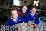 Tralee CBS national school students are using Nintendo DS as a learning tool, pictured are Evan Maher Tracher Michelle Culloty and Sean Bissett..