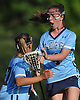 Lindsay Dean #4 of Our Lady of Mercy Academy, right, gets congratulated by Samantha Hungerford #27 after scoring a goal in the second half of the Nassau-Suffolk CHSAA varsity girls lacrosse Class AA final against St. Dominic at Adelphi University on Thursday, May 18, 2017. OLMA won by a score of 10-6.