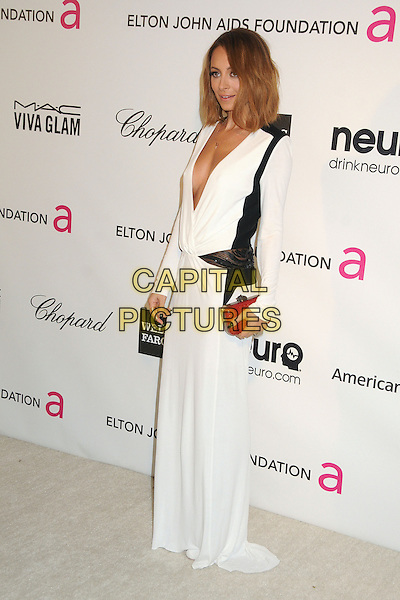 Nicole Richie Madden.21st Annual Elton John Academy Awards Viewing Party held at West Hollywood Park, West Hollywood, California, USA..February 24th, 2013.oscars full length dress long sleeves plunging neckline cleavage red clutch bag white black.CAP/ADM/BP.©Byron Purvis/AdMedia/Capital Pictures.