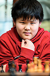 American chess prodigy Awonder Liang, 13, plays a game of chess with mentor, Dr. Dennis Doren, at Doren's home in Madison, Wis., on March 31, 2016. The middle-school student has already won several youth championships and earned the title of International Master. (Photo by Jeff Miller, www.jeffmillerphotography.com)