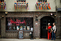 People exit the Stonewall Inn bar in New York. 25.06.2015. The Stonewall Inn, the birthplaces of the modern gay rights movement, the Greenwich Village bar for the LGBT community was made a New York City landmark on Tuesday,  Eduardo MunozAlvarez/VIEWpress.