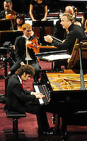 PICTURE BY VAUGHN RIDLEY/SWPIX.COM - Leeds International Piano Competition 2012 - Leeds Town Hall, Leeds, England - 15/09/12 - The winner Federico Colli of Italy with Sir Mark Elder conducting the Halle