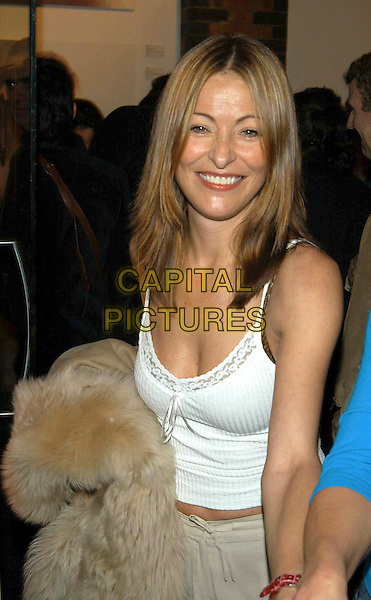 """AMANDA DONOHOE.""""Rankin And Bailey Down Under"""" private view at Proud Camden Moss, London, UK..May 1st, 2003.half length white lace top camisole.CAP/PL.©Phil Loftus/Capital Pictures"""