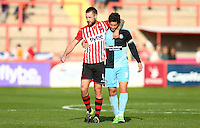 David Noble of Exeter City and Joe Jacobson of Wycombe Wanderers after the final whistle   during the Sky Bet League 2 match between Exeter City and Wycombe Wanderers at St James' Park, Exeter, England on 26 September 2015. Photo by Pinnacle Photo Agency.