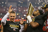 Ohio State Buckeyes head coach Urban Meyer and Ohio State Buckeyes running back Ezekiel Elliott (15) celebrate after the College Football Playoff National Championship between the Ohio State Buckeyes and the Oregon Ducks at AT&T Stadium in Arlington, Texas, Tuesday afternoon, January 13, 2015. The Ohio State Buckeyes defeated the Oregon Ducks 42 - 20. (The Columbus Dispatch / Eamon Queeney)