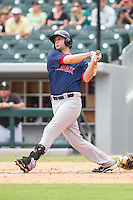 Alex Hassan (21) of the Pawtucket Red Sox follows through on his swing against the Charlotte Knights at BB&T Ballpark on August 8, 2014 in Charlotte, North Carolina.  The Red Sox defeated the Knights  11-8.  (Brian Westerholt/Four Seam Images)